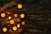 objects for divination runes and candle on a wooden background poster
