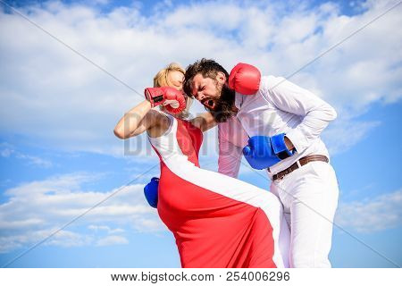Attack Is Best Defence. Defend Your Opinion In Confrontation. Man And Woman Fight Boxing Gloves Sky