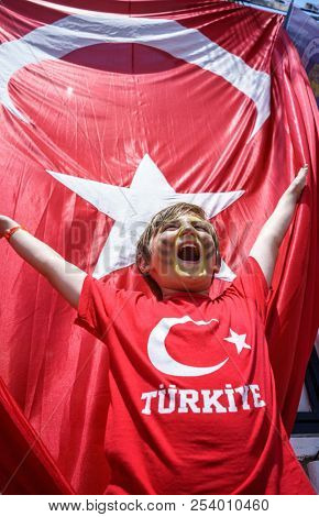Boy and  Waving Fabric Flag of Turkey, Turkish National Flag Fabric Background Texture, Turkey Flag Blowing in the Wind, Realistic Flag of Turkey on Wavy Surface of Fabric, Fluttering Downwind