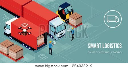 Workers Loading Products On The Trucks And Tracking Delivery With A Tablet: Smart Logistics And Tran