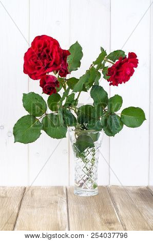 Vintage Crystal Vase With Rose On Rustic Table