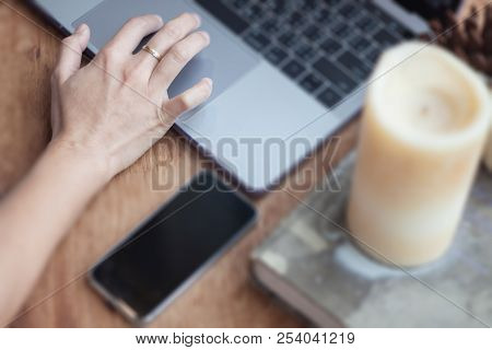 Woman Working On Computer In Coffee Shop, Stock Photo