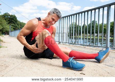 Close-up Of A Mature Man With Sprain Thigh Muscle