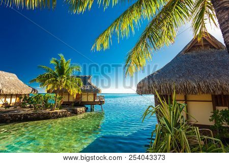 Over water bungalows and amazing green lagoon, Moorea, French Polynesia