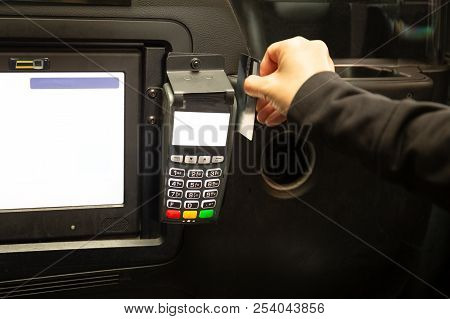 Passenger Paying Taxi Fare With Credit Card In Card Reader.