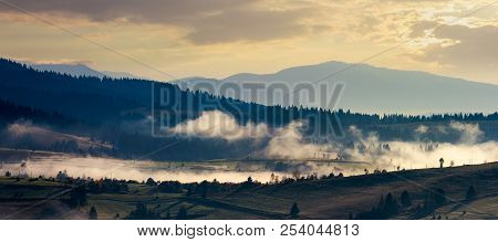 Panorama Of Countryside In The Morning. Beautiful Landscape In Mountains With Fog Rising Above The V