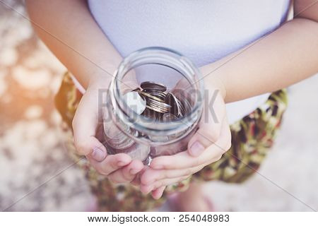 Small Kid Hands Holding Coins, Concept Business