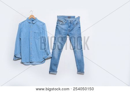 Jeans shirt in hanging and blue denim jeans on hanging Blue denim jean shirt