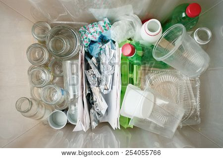 Recycling And Ecology. Sorting Segregating Household Waste Paper, Glass, Plastic Into Contaner Captu