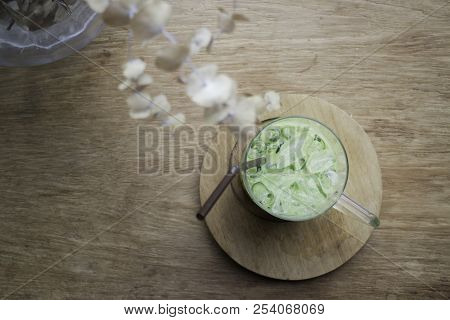 Iced Green Tea Latte On Wooden Table, Stock Photo