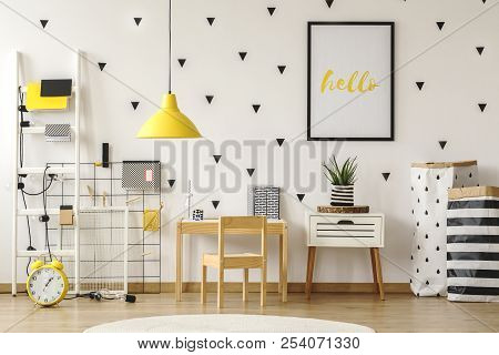 Poster In A Black Frame On A White Wall With Stickers In A Scandinavian Style Child Bedroom Interior