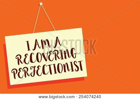 Conceptual hand writing showing I Am A Recovering Perfectionist. Business photo showcasing Obsessive compulsive disorder recovery Beige board communication open close sign orange background. poster