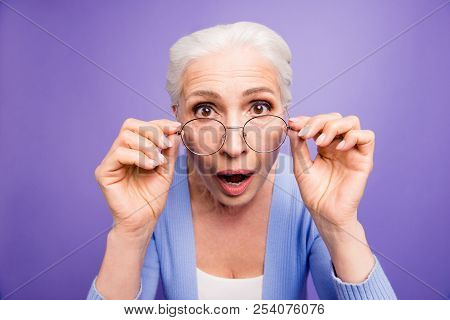 Discounts And Sales What A Great News! Close Up Portrait Of Old Woman Looks Over Her Spectacles In S