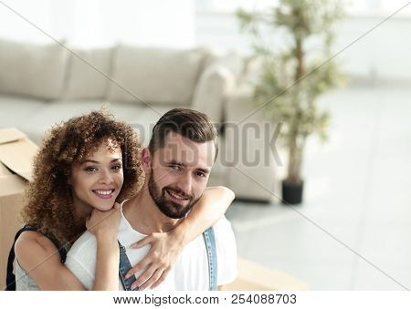 Close-up portrait of a newly-married couple in work clothes