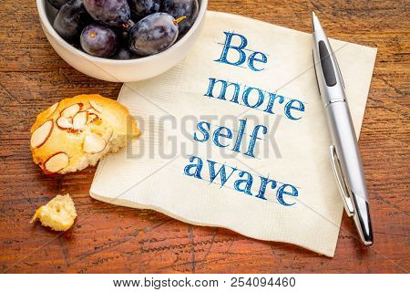 Be more self aware reminder - handwriting on a napkin with grapes and cookie