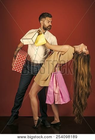 Shopping And Sale. Girl And Bearded Man Hold Present Pack, Cyber Monday. Couple In Love Hold Shoppin