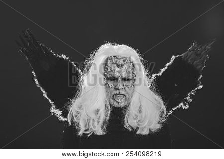 Wizard With Long Silver Hair On Dark Background. Dragon With White Eyes And Sharp Thorns On Face. Ma