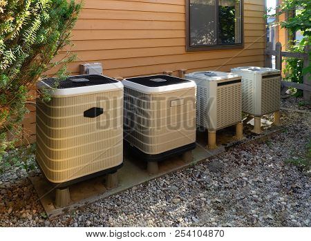 Air Conditioning And Heating Units Outside Of A Home