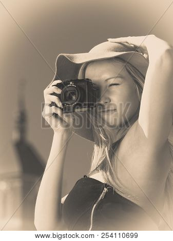 Tourism, Artistic, Elegant Fashion. Woman In Elegant Outfit And Sun Hat Taking Pictures, Sepia