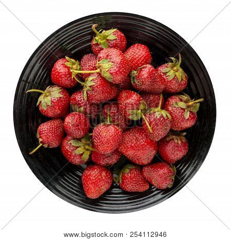Strawberries On A Plate Isolated On White Background. Strawberry On A Plate Top View . Healthy Food