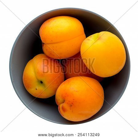 Apricots On A Plate Isolated On A Bacground Background. Apricots On A Plate Top View. Healthy Food
