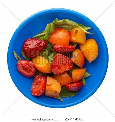 Spinach, Apricot, Strawberry On A Plate Isolated On A White Background. Spinach, Apricot, Strawberry