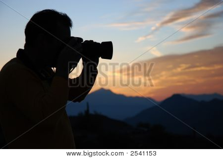 Photographer Capturing The Sunset