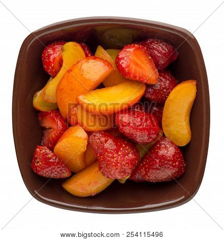 Strawberry And Apricot Sliced On A Plate Isolated On White Background. Strawberry And Apricot Sliced