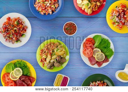 Meat Dishes On A Plate. Salads On A Plate. The Abundance Of Food On The Table.
