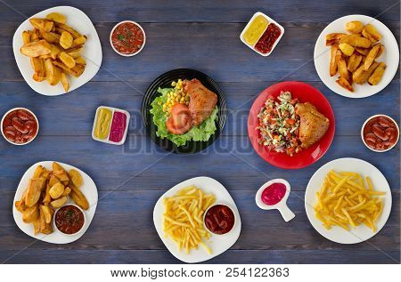 Junk Food . Fast Food. French Fries, Leg, Sauces On The Table