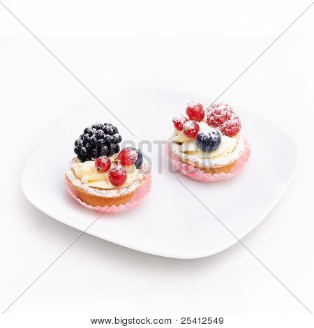Two Cakes On The Plate. Isolated.