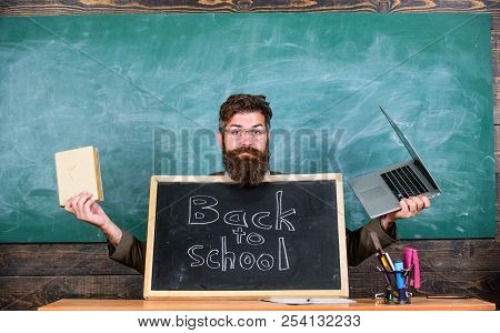 Teacher Welcomes New Pupils Enter Educational Institution. Teacher Or School Principal Welcomes With