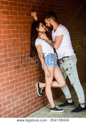 Desire And Temptation. Couple Enjoy Intimacy Moment Without Witnesses. Girl And Hipster Strong Desir