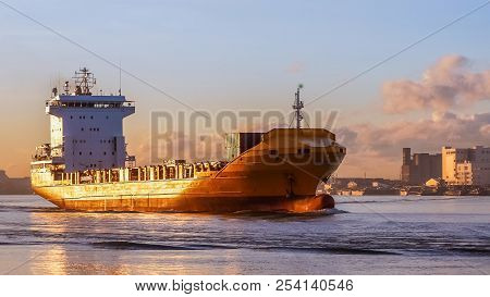 Cargo Ship Is Sailing To Sea To Transport Cargo In Containers.logistics And Transportation Of Intern