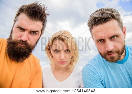 Group People Suspect You. Suspicious Look. Threesome Suspiciously Look Down. Woman And Men Look Conf