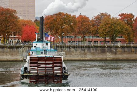 Short depth of field image of the back of a paddle boat steamer on the Williamette river in Portland