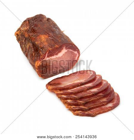 Piece of spanish Lomo Embuchado meat and slices isolated on white background