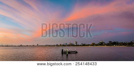 Melbourne Skyline And Skyscrapers With A Pink And Purple Sunset In The Sky