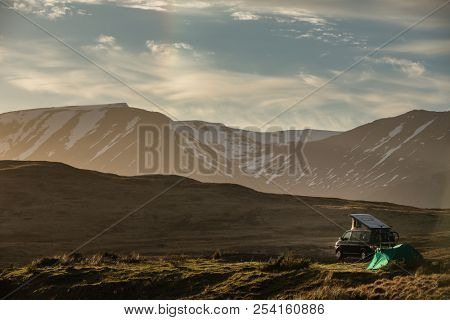 Highlands of Scotland - someone found a lovely spot for tonight - camper and a tent in a splendid landscape