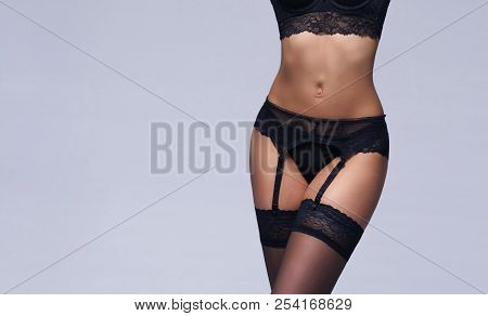 Female Body In Sexy Underwear. Young Brunette Woman In Lingerie.