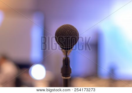 Close-up Of Microphone In Seminar Room Or Conference Hall Light For Speaking Or Talking For Lecture.
