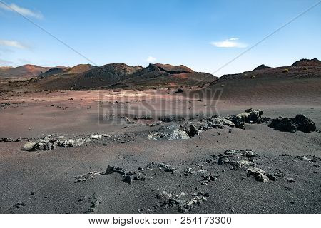 Unique Volcanic Landscapes Of Timanfaya National Park, Lanzarote, Canary Island. Nature Background.