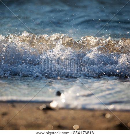 Sandy beach foam, sea splash, sea waves