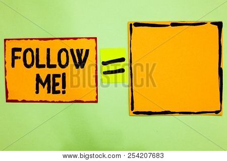 Writing note showing Follow Me. Business photo showcasing Inviting a person or group to obey your prefered leadership Orange paper notes reminders equal sign important messages to remember. poster