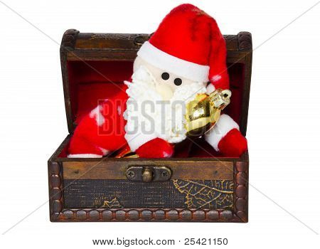 Toy santa klaus in an antiquarian chest on a white background poster