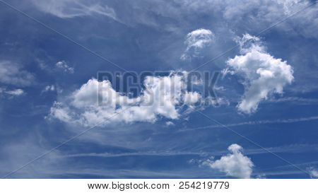 Puffy white clouds blue sky day with bright sun shining bright 4K video resolution poster