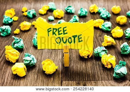Writing note showing Free Quote. Business photo showcasing A brief phrase that is usualy has impotant message to convey Clothespin holding yellow note paper crumpled papers several tries. poster