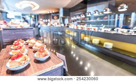 Buffet At Hotel Restaurant Interior Blur Background For Breakfast, Lunch Or Dinner Meal With Blurry