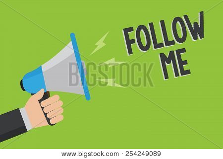 Writing note showing Follow Me. Business photo showcasing Inviting a person or group to obey your prefered leadership Man holding megaphone loudspeaker green background message speaking. poster