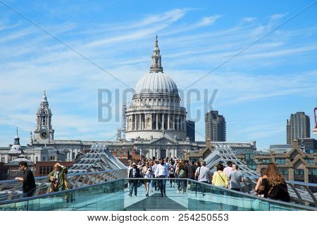 LONDON, UK - JUNE 10 , 2017:  People walking across the Milenium bridge to St. Paul Cathedral by a nice sunny  day in London